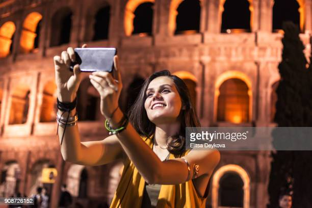 Smiling girl with phone