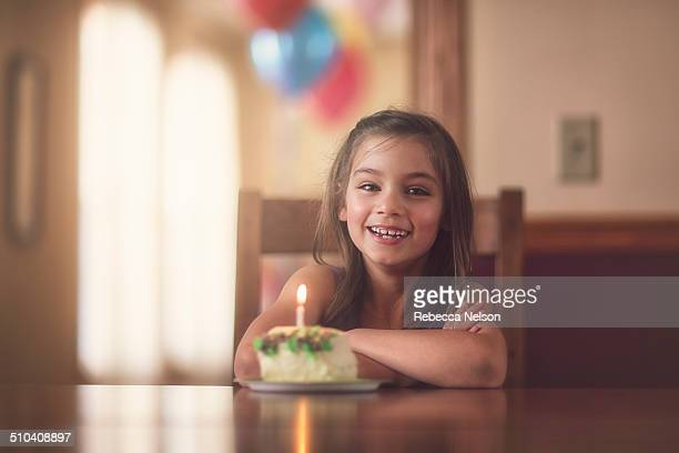 smiling girl with piece of birthday cake