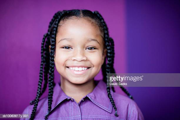 smiling girl (8-9) with plaits, portrait, close-up - alleen één meisje stockfoto's en -beelden