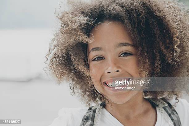 Smiling girl with wind in hair