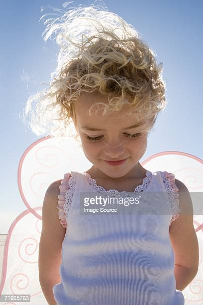 Smiling girl with wings,
