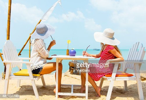 Smiling Girls In Cafe On The Beach Stock Photo Getty Images