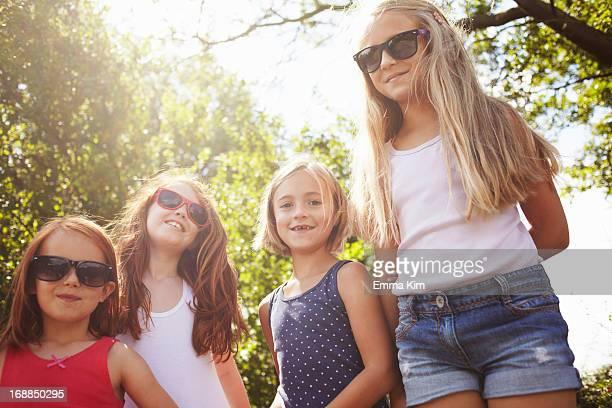 smiling girls standing outdoors - biggin hill fotografías e imágenes de stock