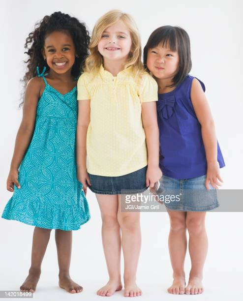 smiling girls standing together - funny black girl stock photos and pictures