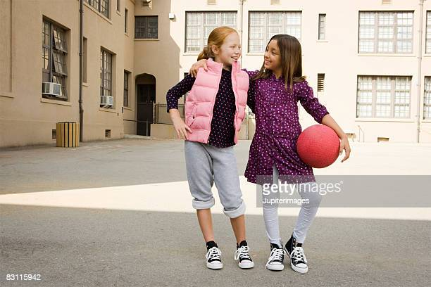 Smiling girls with dodgeball