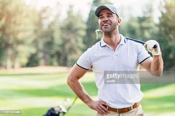 smiling golfer - baseball cap stock pictures, royalty-free photos & images