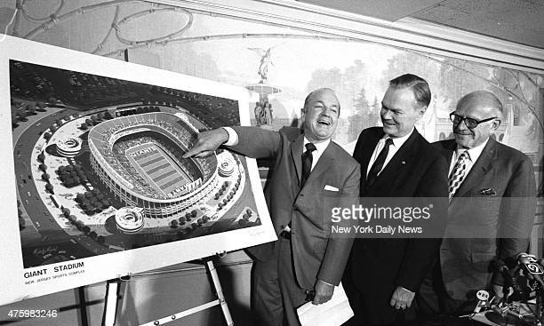 Smiling Gov William Cahill points to drawing of stadium the Giants will inhabit in East Rutherford Standing by are Giants President Wellington Mara...