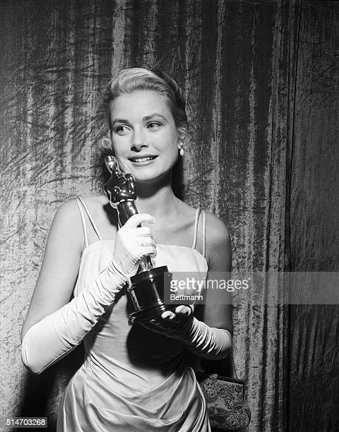 A smiling Grace Kelly clutches her Oscar after winning the coveted Academy Award March 30th as 'Best Actress' of 1954 Miss Kelly won for her role in...