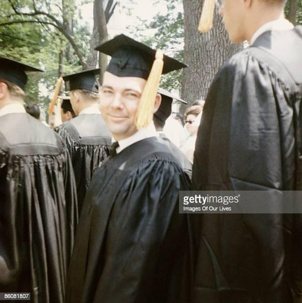 Smiling graduate during ceremony