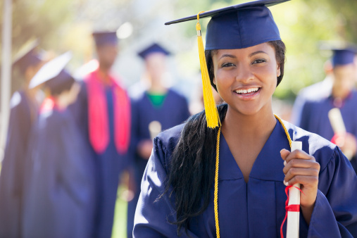 Smiling graduate holding diploma - gettyimageskorea