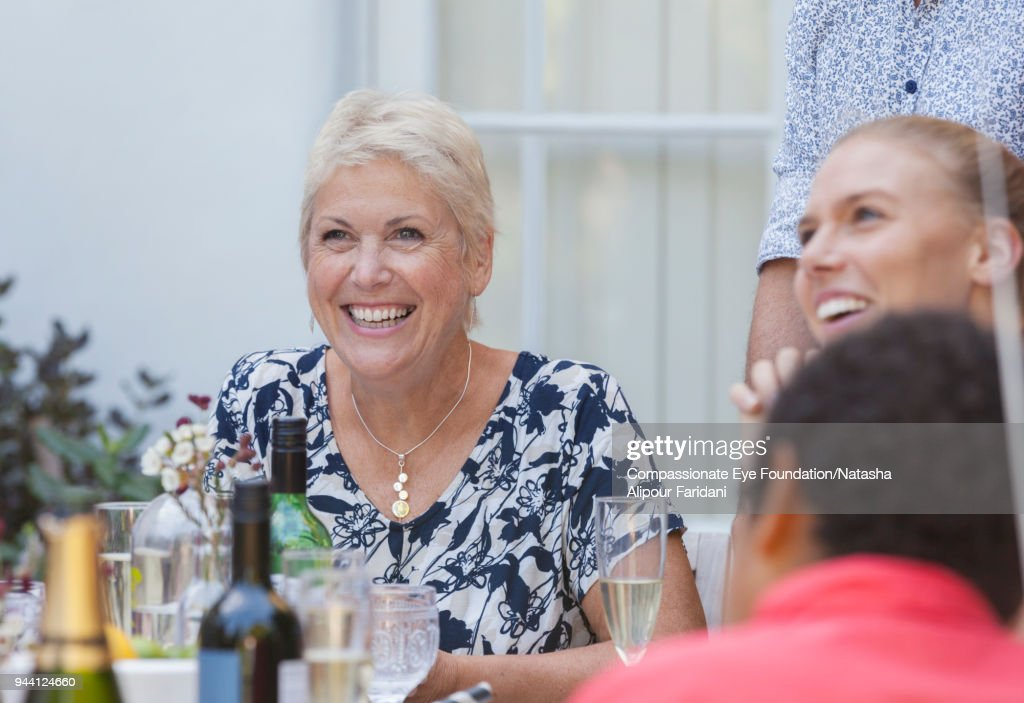 Smiling grandmother at multi generation celebration lunch : Stock Photo