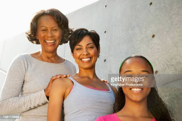 Smiling grandmother, mother and daughter