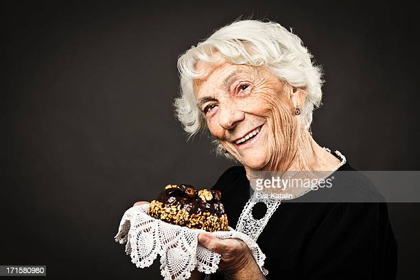 smiling grandmother - fruit cake stock pictures, royalty-free photos & images