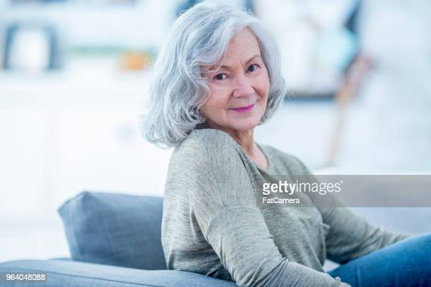 smiling grandmother - fatcamera stock pictures, royalty-free photos & images