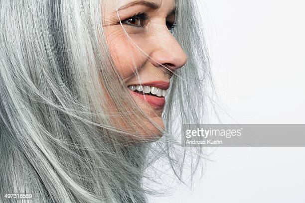 smiling grey haired woman, profile. - capelli grigi foto e immagini stock