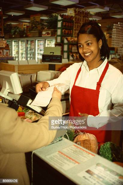 Smiling grocery store cashier