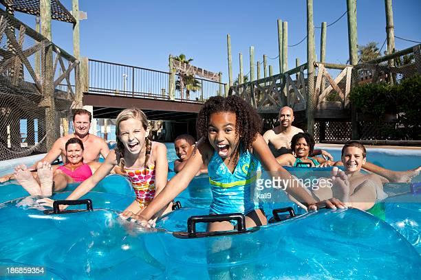 Smiling group at water park in innertubes