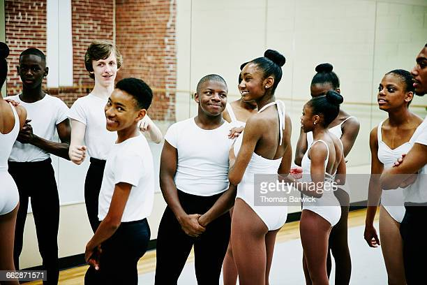 Smiling group of ballet students in discussion