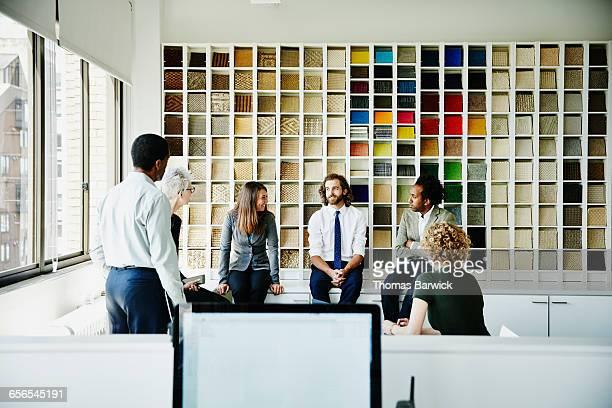 Smiling group of businesspeople in discussion