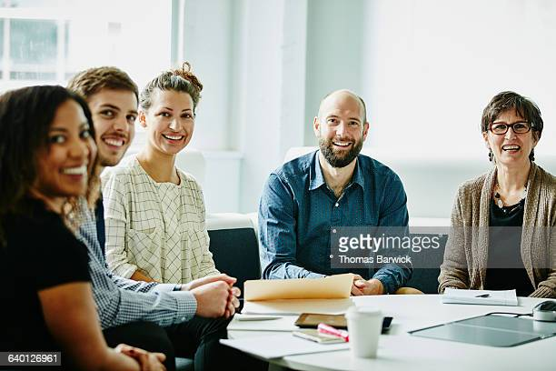 Smiling group of businesspeople in team meeting