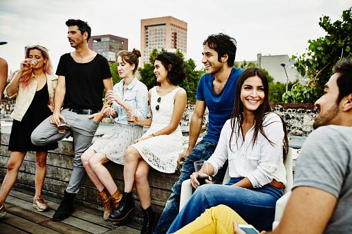Smiling group of friends having drinks together - gettyimageskorea