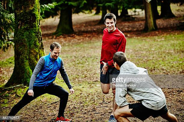 Smiling group of friends stretching before run