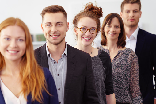 Smiling group of young professionals in office 1146844837