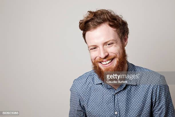smiling guy - men laughing stock pictures, royalty-free photos & images