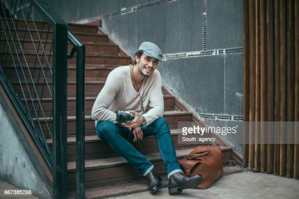 smiling guy with a camera - south_agency stock pictures, royalty-free photos & images