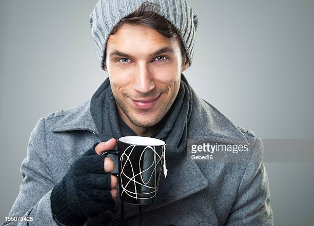 Smiling guy with cup of tea