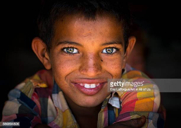 Smiling gypsy boy with beautiful eyes central county kerman Iran on January 1 2016 in Kerman Iran