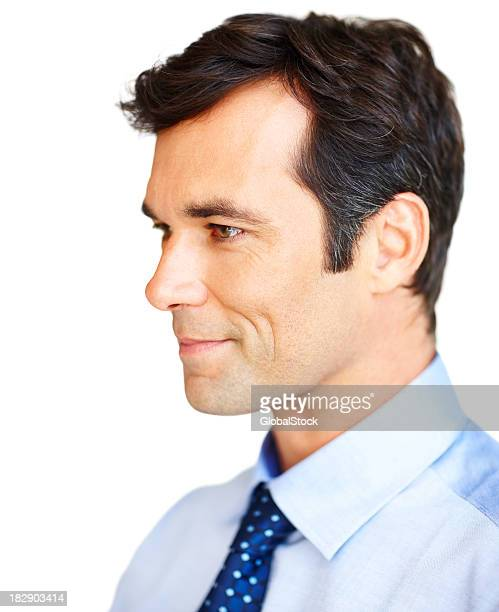 Smiling handsome businessman against white background