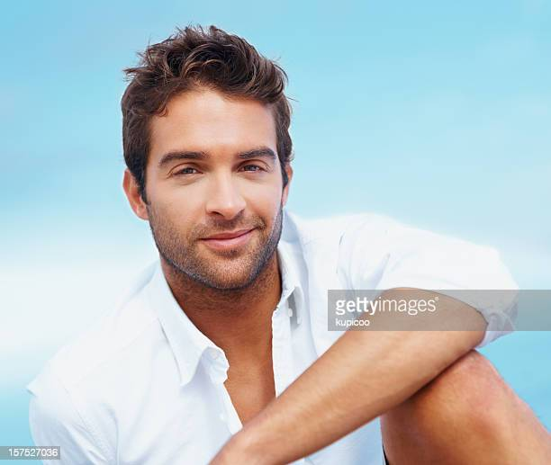 Smiling handsome man against a natural background