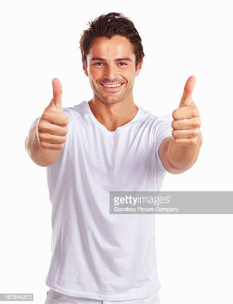 Smiling handsome man showing thumbs up sign