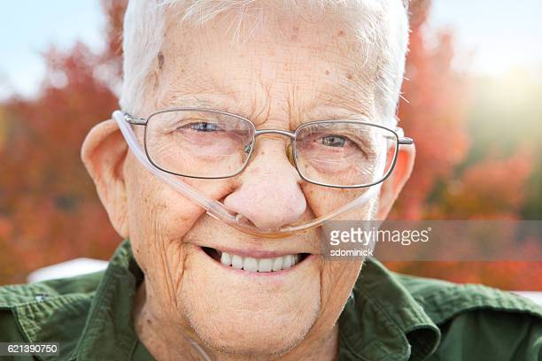 smiling handsome senior man close up - copd stock photos and pictures