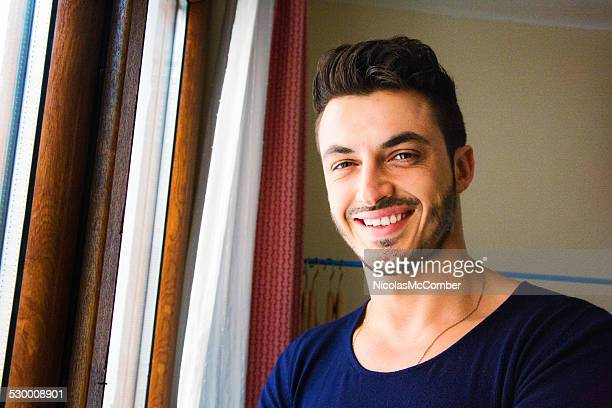 Smiling handsome young middle-eastern man portrait
