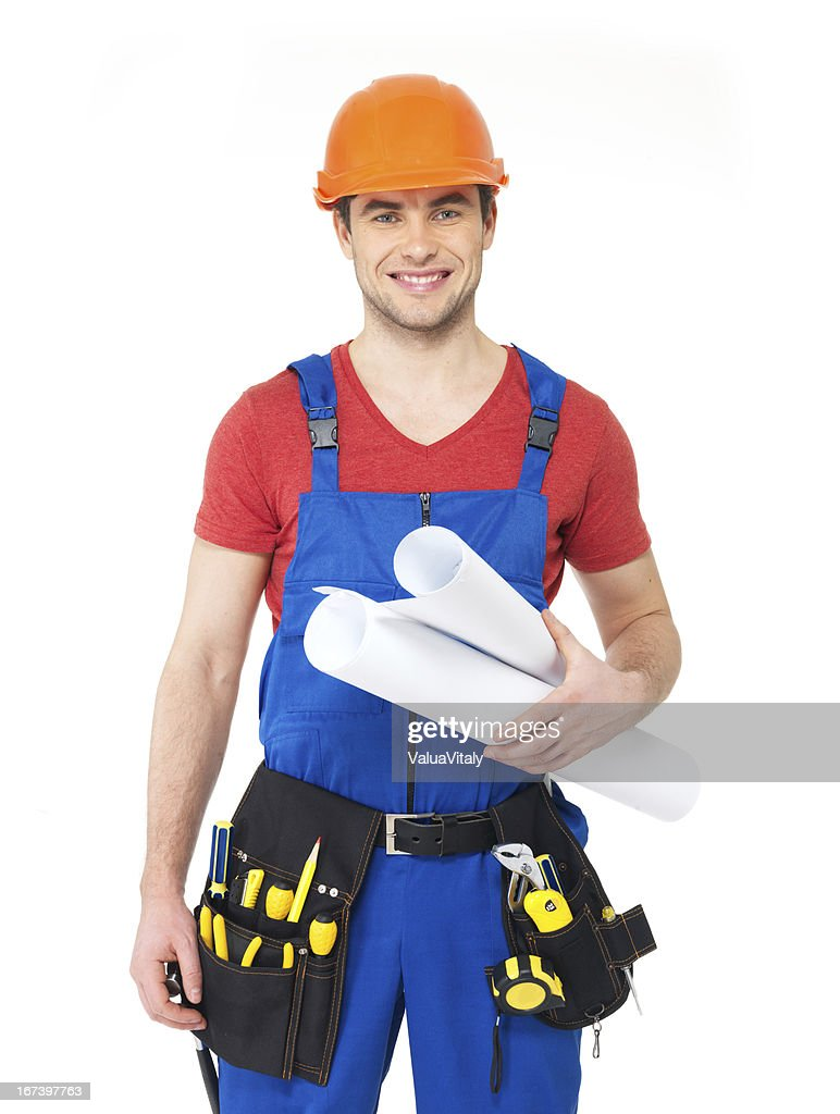 Smiling handyman with tools and paper : Stock Photo