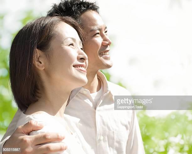 smiling happy couple - 中年カップル ストックフォトと画像
