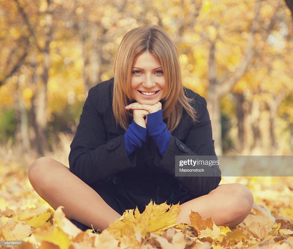 Smiling happy girl in autumn park. : Stock Photo