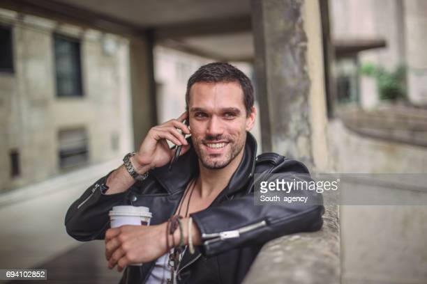 smiling hipster talking on the phone - bracelet stock pictures, royalty-free photos & images