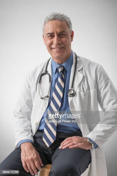 Smiling Hispanic doctor wearing stethoscope