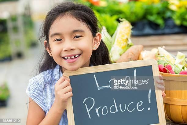 Smiling Hispanic Girl at farmers market