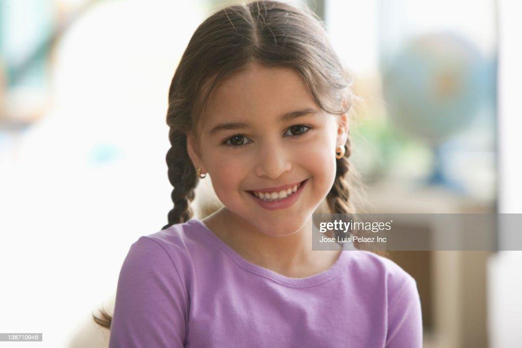 Smiling Hispanic girl : Stock Photo