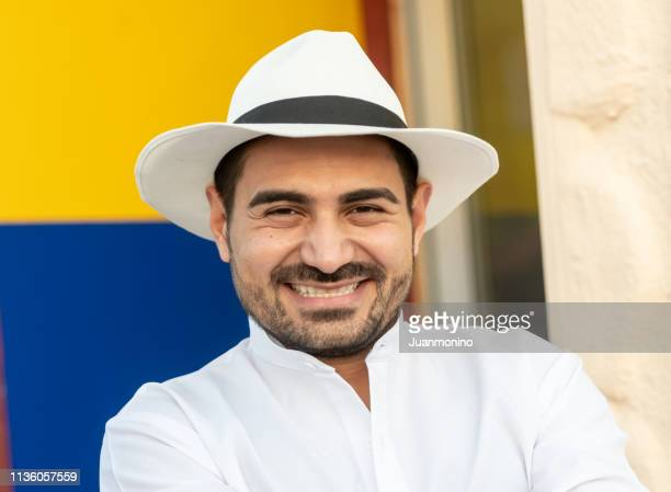 smiling hispanic man with paisa hat - emigration and immigration stock pictures, royalty-free photos & images