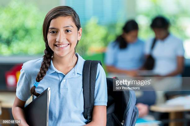 smiling hispanic middle school student in class - charter_school stock pictures, royalty-free photos & images