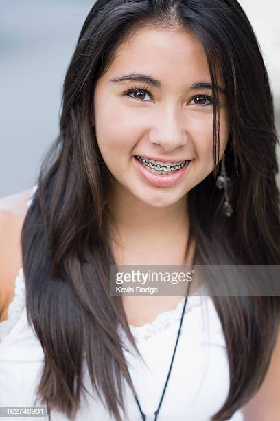 smiling hispanic teenager - beautiful girl smile braces vertical stock photos and pictures