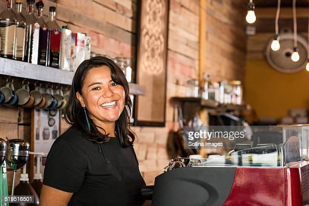Smiling Hispanic woman working in coffee shop