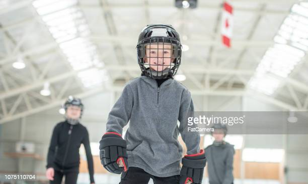 smiling hockey player - hockey player stock pictures, royalty-free photos & images