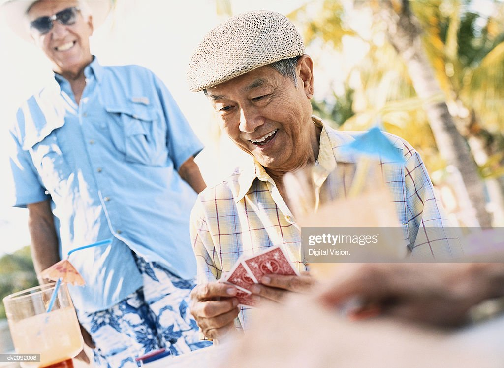 Smiling Holding a Set of Playing Cards : Stock Photo