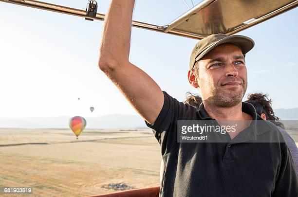Smiling hot air balloon pilot